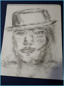 Sample of a Spirit Portrait Drawing by Medium Eileen Casey Gonzalez. Drawing is of a man with a type short top hat, clean shaven. It is an image drawn on etch paper with graphite.