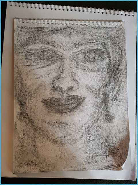 Sample of a Spirit Portrait Drawing by Edmonton Psychic Clairvoyant Medium Eileen Casey Gonzalez. The image is drawn in charcoal. It is an image of an older woman's face. She has curly hair and drop earnings.