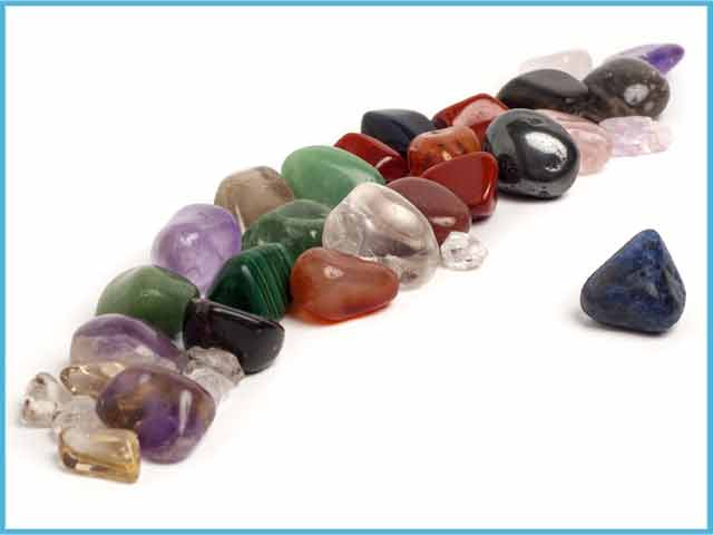 Image of polished crystals and stones in a row.
