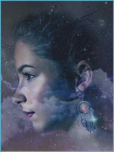 Image of a woman's face faded against a background of a night full of stars. Meant to represent an image of a Spirit Guide.